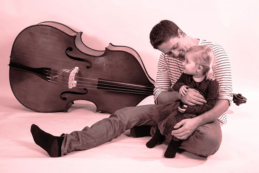 Dad, child and guitar