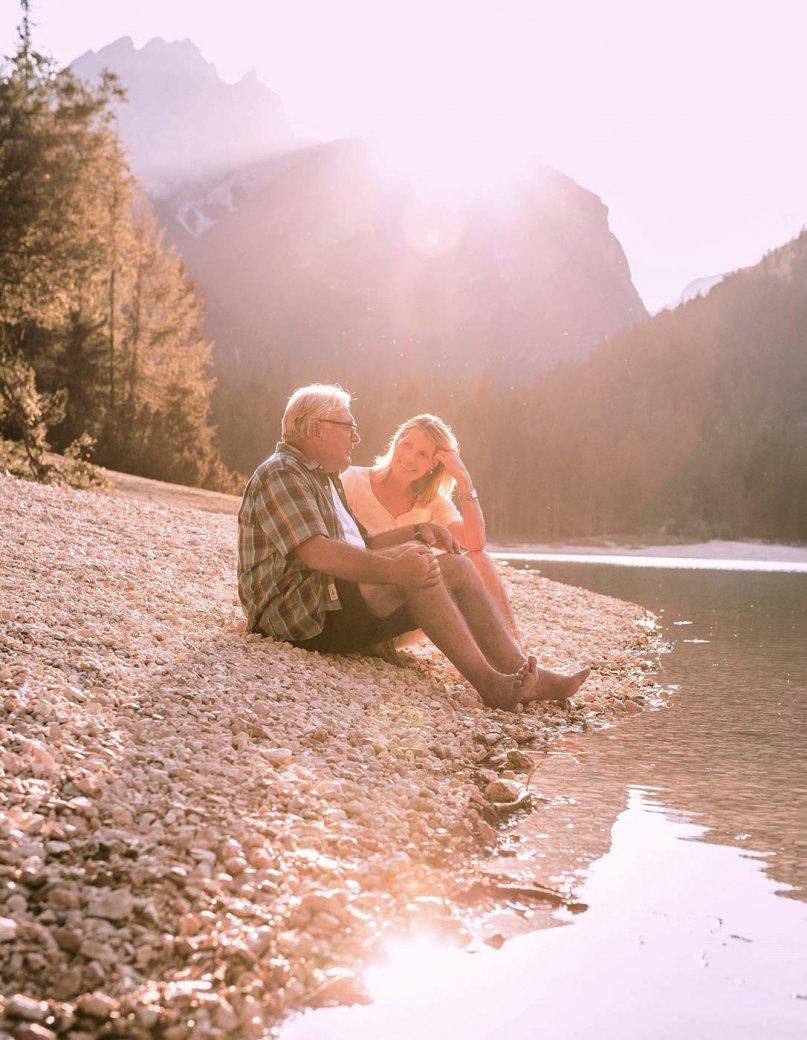 People sitting near a lake